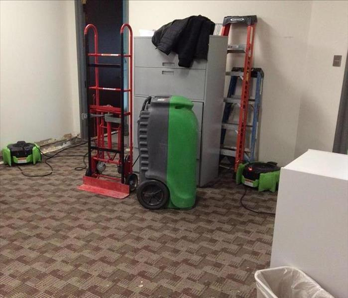 Concord Accounting Office Assesses Water Damage Before