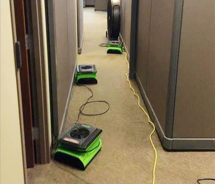 equipment placed in hallway during drying process